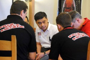 Master Coach Julius Ordoñez in a huddle with coachees