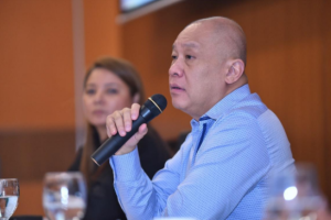 Globe President & CEO Ernest Cu reports the company's record revenue performance in 2017 at an analyst briefing held at the telecommunication provider's headquarters in Bonifacio Global City while Chief Finance Officer Rizza Maniego-Eala looks on.